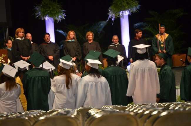 The graduates upstage the board. Click on the image for larger view. (© FlaglerLive)