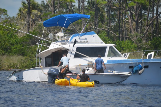 The boat was sinking just north of mile marker 22 in the Intracoastal Waterway. Click on the image for larger view. (© FlaglerLive)