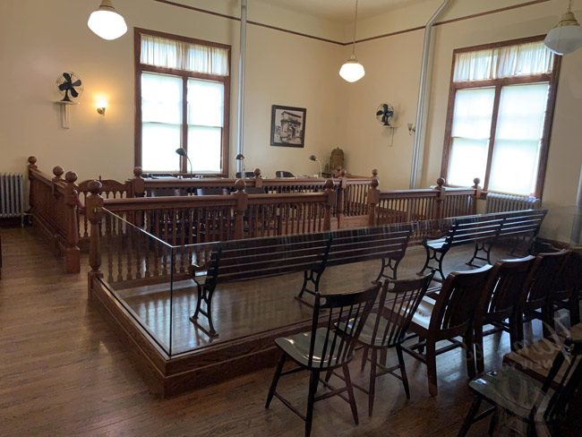 The hearing room at Ellis Island, where a board stood in the way of immigrants' entry and eventual path to citizenship. (© FlaglerLive)