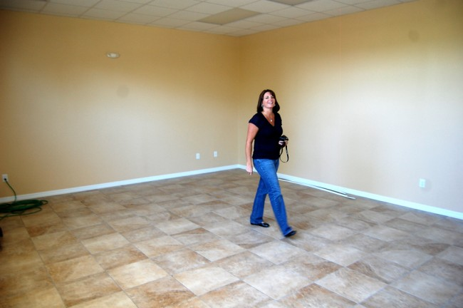 The county's Heidi Petito, who was chiefly responsible at the execution end of Carver's reconstruction, in one of the ground-floor rooms that'll soon be Carver's lounge. Click on the image for larger view. (© FlaglerLive)