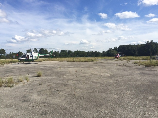 Two of the helicopters that took part in the search. Click on the image for larger view. (c FlaglerLive)