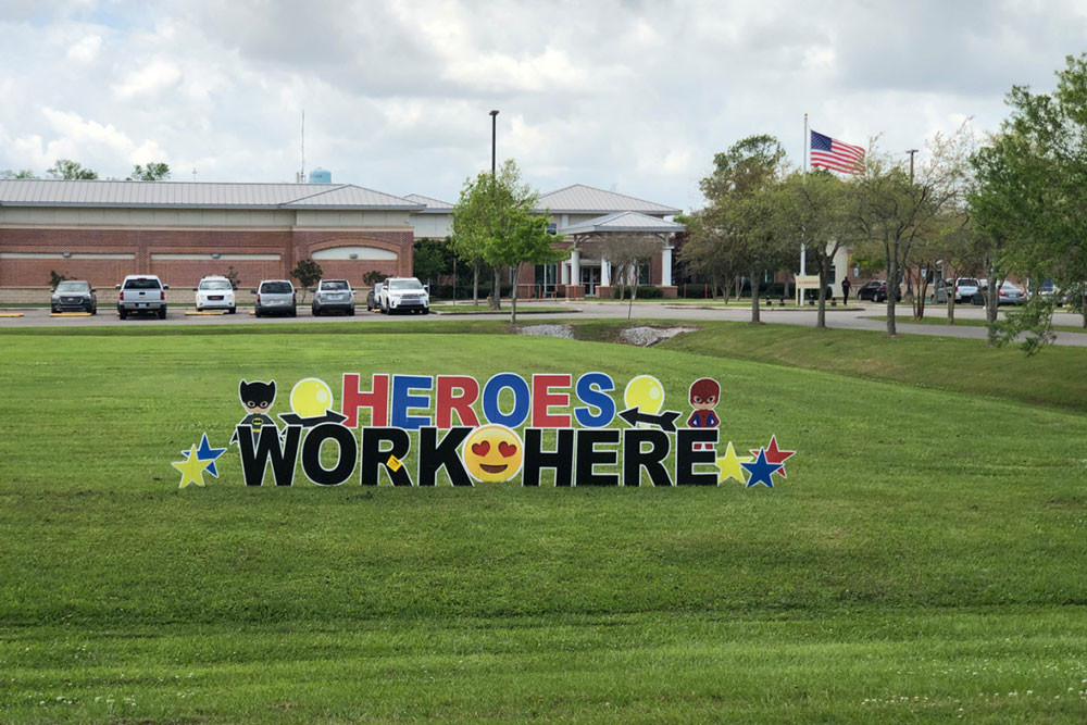 "A sign declaring ""HEROES WORK HERE"" decorates the lawn of St. James Parish Hospital, a 25-bed rural hospital located about 45 minutes from New Orleans, a pandemic hot spot. (Courtesy of St. James Parish Hospital)"