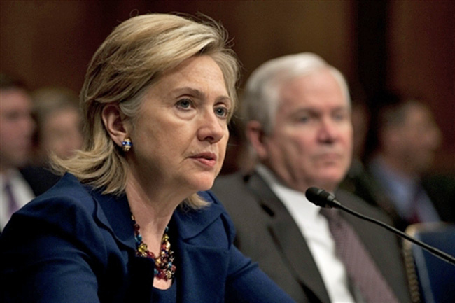 Hillary Clinton and then-Defense Secretary Robert Gates, in the background, teamed up to prop up a thuggish regime in Honduras. ( Chad J. McNeeley)