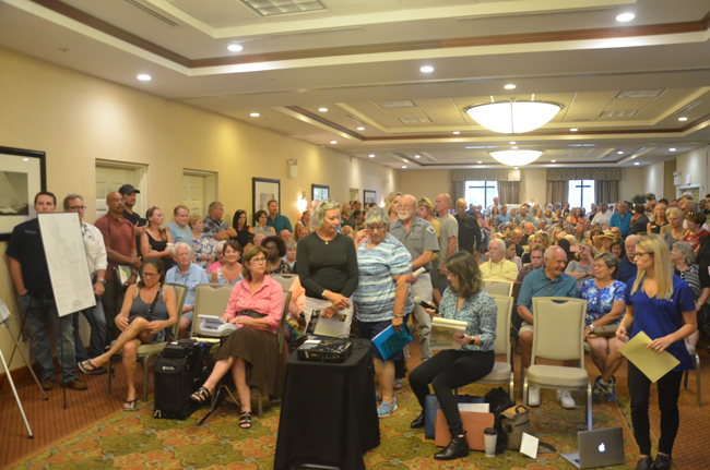A crowd far above capacity filled the conference room at the Hilton Garden Inn this evening. (c FlaglerLive)