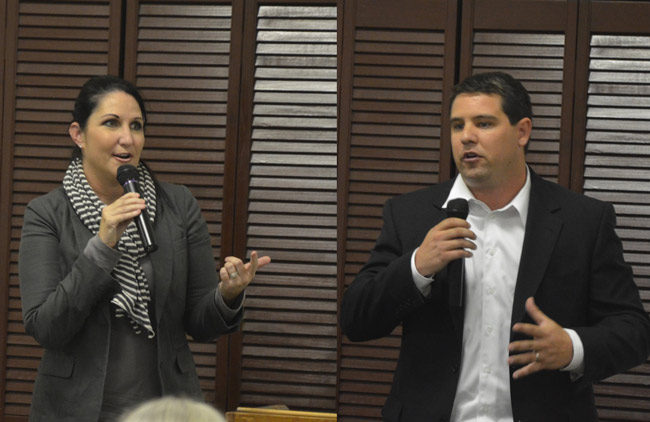 There are plenty of reasons to argue who might make the best candidate. The majority or minority status of each candidate's party is not one of them. Above, Democrat Milissa Holland and Republican Travis Hutson, candidates for the Florida House seat that includes all of Flagler County, last week at the Flagler Women's Club. (© FlaglerLive)