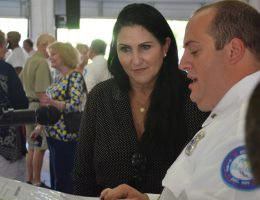 Palm Coast Mayor Milissa Holland and the Fire Department's Patrick Juliano going over ceremony timing before the event. (© FlaglerLive)