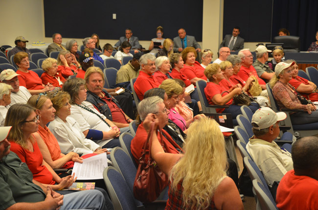 A mass of red-shirted supporters of Bunnell's First United Methodist Church and its works on behalf of the homeless filled the chambers of the Bunnell City Commission Monday evening. (© FlaglerLive)