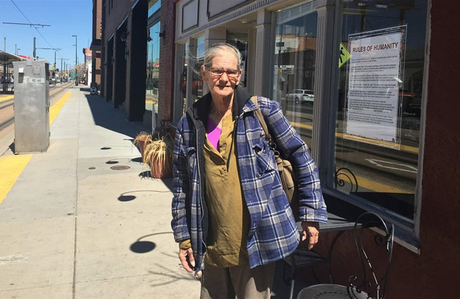 Debbie Hyatt stands outside the Impact Humanity store in downtown Denver. She sleeps in a shelter now but for a time slept on the sidewalk. (Pew Charitable Trust)