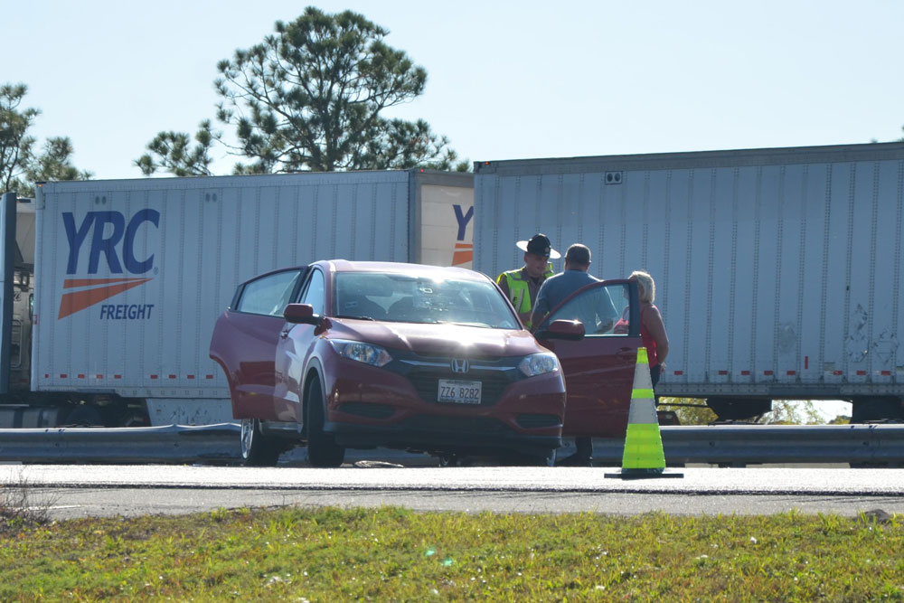 The Honda was a few dozen yards behind the SUV and the van. (© FlaglerLive)