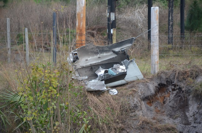 The semi traveled across the pond (more than 30 feet across) before crashing down, leaving parts of its hood on the other side of the embankment. Click on the image for larger view. (© FlaglerLive)
