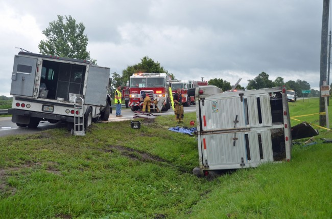 The pick-up truck and the trailer were catapulted into the ditch by the force and weight of the armored truck. Click on the image for larger view. (© FlaglerLive)