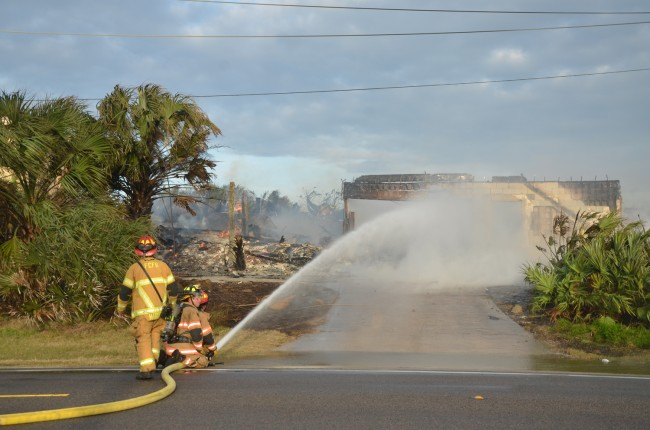 Only a shell was left of the house after an hour. Click on the image for larger view. (© FlaglerLive)