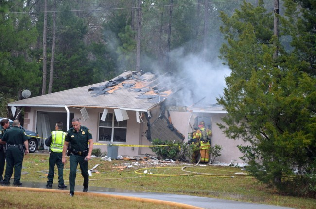 The house was a ruin when flames were knocked out. Click on the image for larger view. (© FlaglerLive)