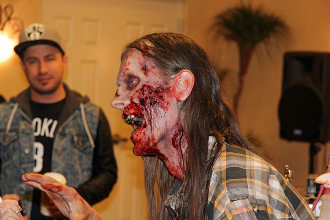 Make-up expert Laura Tyler put on a show as she transformed Timber Weller into a zombie during the Flagler Film Festival last weekend at the Hilton Garden Inn in Palm Coast. (© FlaglerLive)