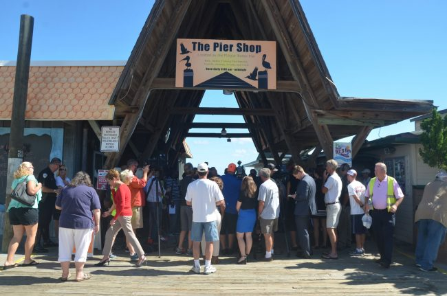 Media and officials huddled around Sen. Bill Nelson for 45 minutes at the pier this morning.