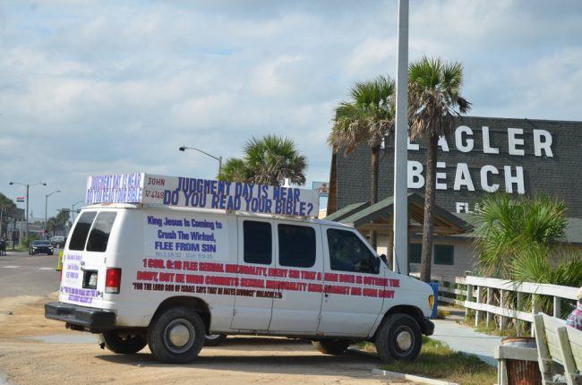 Parked by the Flagler Beach pier Friday: 'I make well-being and create calamity,' God says in Isaiah (45:7), so you know who to blame for Hurricane Irma. (© FlaglerLive)
