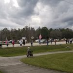 Indivisible Flagler's demonstration in Palm Coast in support of the impeachment of President Trump, echeduled in the House of Representatives on Wednesday afternoon. The demonstration took place along State Road 100, near Panera Bread, one of 600 such demonstrations across the country. (© FlaglerLive)