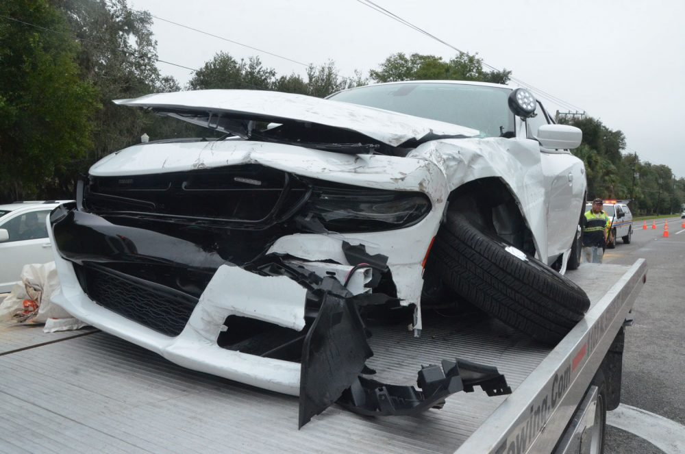 Flagler County Sheriff's Deputy Kyle Gaddie's new Dodge Charger was likely totaled in the wreck today off 16th Road in the Hammock. (© FlaglerLive)