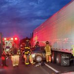 The three occupants of the Lincoln Town Car escaped with only minor injuries in a crash with a semi on I-95 Friday evening. (FCSO)