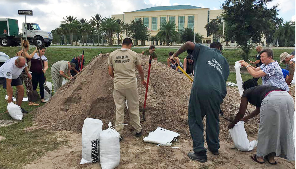 Inmates helped fill sandbags in Bunnell in preparation for Hurricane Irma two years ago. (c FlaglerLive)
