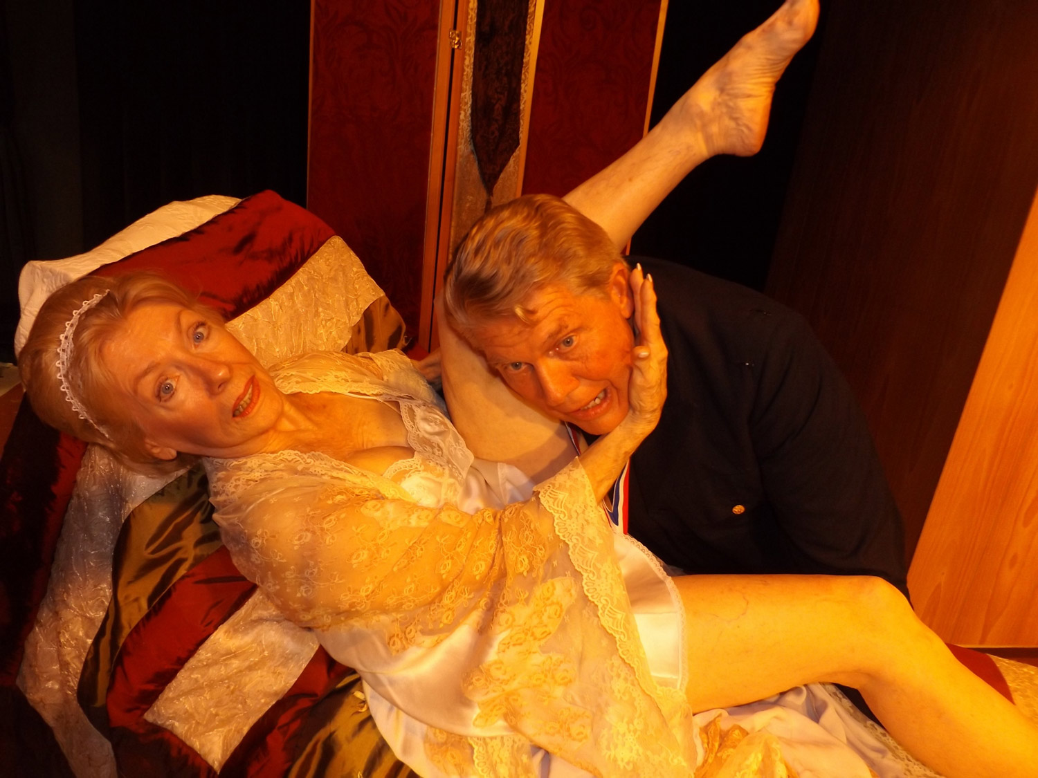 General Léon Saint-Pé (John Pope) and his wife, Mme. Saint-Pé (Anne Kraft), inflict marital discord on each other in 'The Waltz of the Toreadors,' the play staged all weekend at City Repertory Theatre in Palm Coast. See below. Click on the image for larger view. (© FlaglerLive)