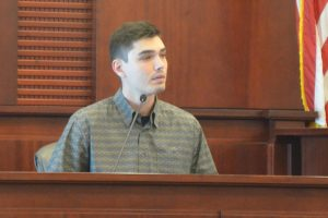 Ivan Tsabak, Vitaly's little brother, on the stand today. (© FlaglerLive)