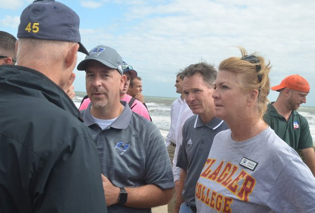 Jacob Oliva, center, speaking with Gov. Rick Scott in Flagler Beach in October. Vernon Orndorff, right of Oliva, has been Oliva's deputy and is his likely successor. School Board member Colleen Conklin is to the right. (c FlaglerLive)