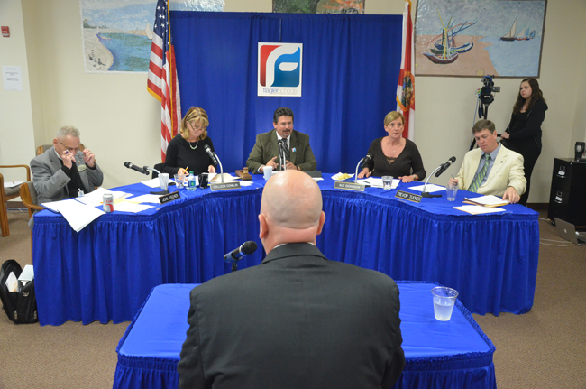 Jacob Oliva is usually seated alongside Flagler County School Board members, as their acting superintendent. Thursday morning, he was acing them for two hours in a broad-ranging job interview. (© FlaglerLive)