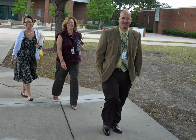 Jacob Oliva with Flagler Palm Coast High School's new principal, Lynette Shott, and Superintendent Janet Valentine. (© FlaglerLive)