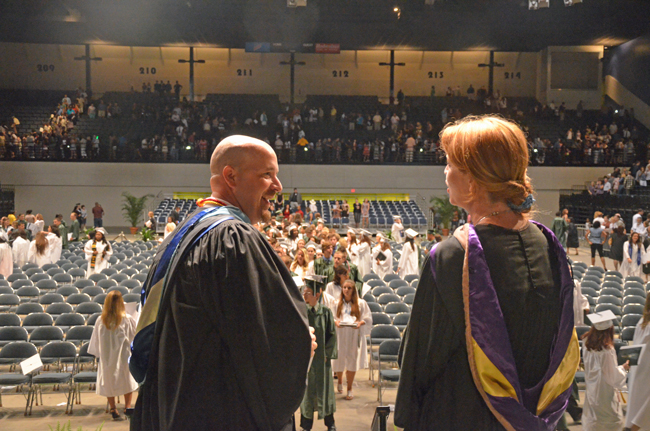 Jacob Oliva, seen here  at his last graduation as FPC principal in May 2012, a few days before his appointment as assistant superintendent, has almost always enjoyed most-favored status among school board members. Board member Colleen Conklin is to his right. (© FlaglerLive)