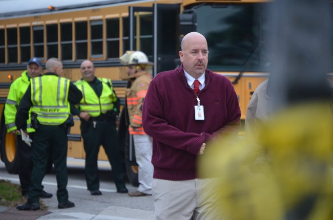 Superintendent Jacob Oliva was at the crash scene before heading to the hospital to confer with parents, students and health officials. Click on the image for larger view. (c FlaglerLive)