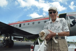 James Kade, 91, a former Luftwaffe airman, with his dog Jackie just before going aboard the Spirit of Freedom. Click on the image for larger view. (© FlaglerLive)