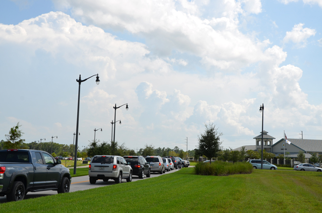 Jamming at Imagine: the car lines in Town Center stretched roughly a mile between the two directions, bringing traffic to a near-standstill Monday afternoon.  (© FlaglerLive)
