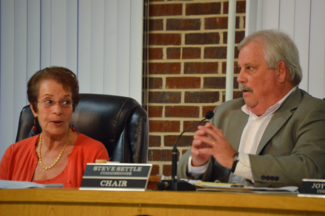 Commissioners Jane Mealy and Steve Settle have a serrated history. (© FlaglerLive)