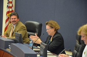 'I'm very proud to be superintendent of Flagler County schools right now,' Janet Valentine said. She is flanked by board members  Andy Dance and Sue Dickinson. Click on the image for larger view. (© FlaglerLive)