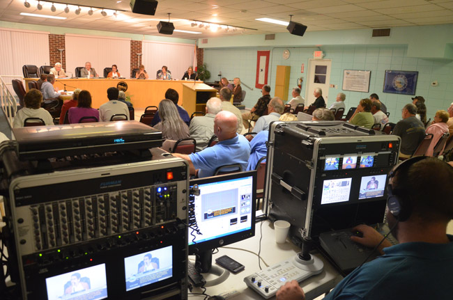 Palm Coast TV's Jason Giraulo at the controls during a Flagler Beach City Commission meeting. The production set-up will be history beginning in October, when Flagler Beach replaces the system with live, web-streaming of meetings through a single camera in back of the meeting room. (© FlaglerLive)
