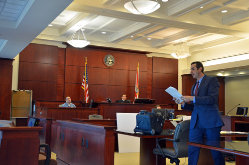 Assistant State Attorney Jason Lewis, right, cross-examining Michael Renaud as Circuit Judge Dennis Craig presided this afternoon. (© FlaglerLive)