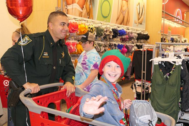Jeffrey Foust, 11, with Flagler County Sheriff's Cmdr. Phil Reynolds at the Christmas with a Deputy event on Friday evening. (FCSO)