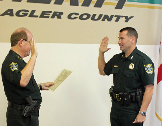 Jeff Hoffman, right, is sworn in by Sheriff Jim Manfre today. (FCSO)
