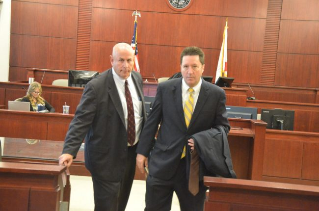 Defense attorneys Jeff Stone and Michael Nielsen leaving the courtroom after the verdict. (© FlaglerLive)