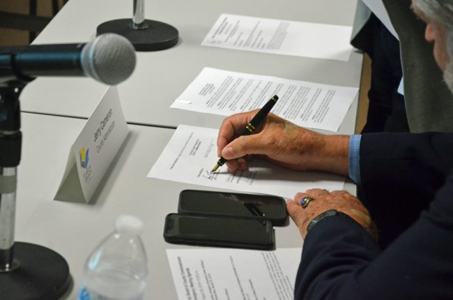 Flagler County Administrator Jerry Cameron signing Flagler's Emergency Declaration on Aug. 29. (© FlaglerLive)