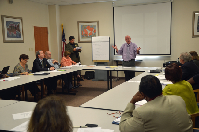 Jerry Copeland, the Flagler school district management's  skilled collective bargaining negotiator and a virtual colleague of Jacob Oliva's in that capacity, led members of the superintendent search committee in discussion Tuesday afternoon. To his right was Andy Dance, the chairman of the school board. (© FlaglerLive)