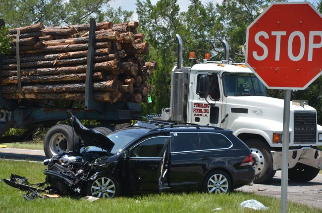The Jetta and the logging truck. Click on the image for larger view. (© FlaglerLive)