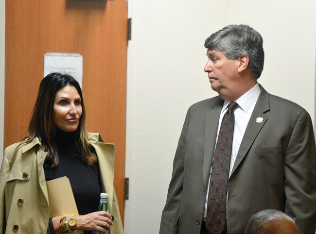 Who's scripting whom? Palm Coast Mayor Milissa Holland and City Manager Jim Landon. (© FlaglerLive)