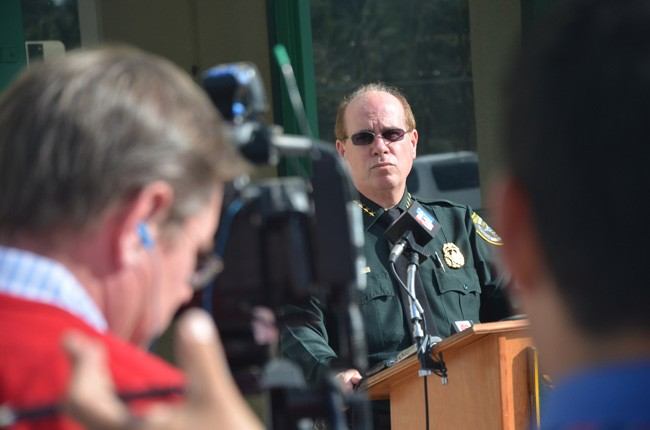 Flagler County Sheriff Jim Manfre, seen here during an unrelated news conference in 2013, ended one of three litigation matters facing the agency. (© FlaglerLive)