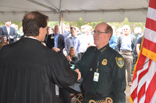 Flagler County Circuit Judge Dennis Craig administered the oath of office to Jim Manfre for his second go-around. (© FlaglerLive)