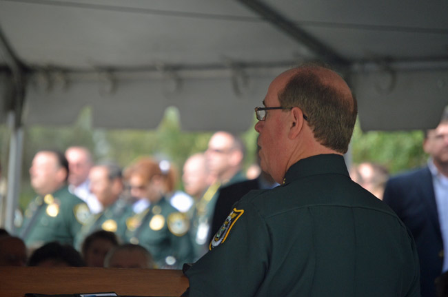 Returning deputies to elementary schools was one of Jim Manfre's campaign issues. He is seen here at his January inauguration. (© FlaglerLive)