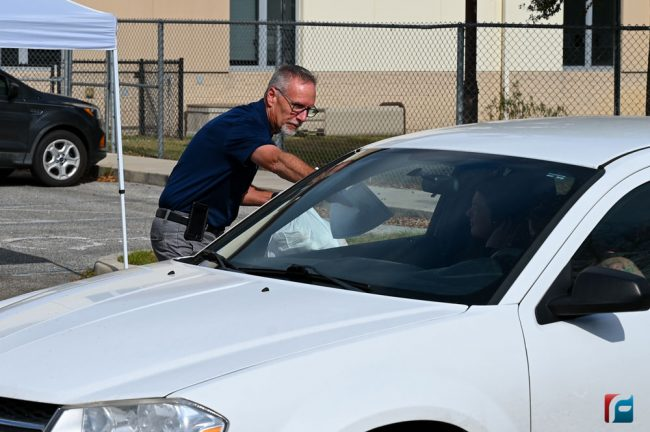Superintendent Jim Tager distributing meals earlier today at Buddy Taylor Middle School. (Flagler Schools)