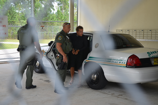 Joseph Bova, the suspect in the Rosado murder, arriving at the Flagler County jail from Boca Raton on Sept. 14, the day after his arrest in September. (© FlaglerLive)