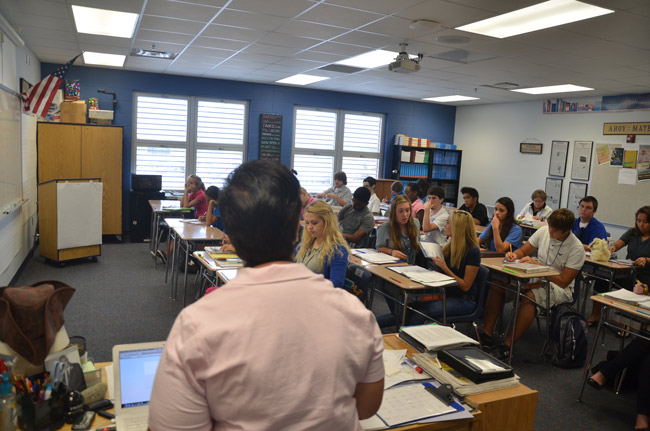 Where she'd rather be: the author, in her classroom at Matanzas High School, the day before she took a three-month leave for cancer treatment. She goes into surgery on Tuesday, Nov. 13. (© FlaglerLive)